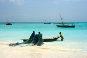 Men preparing their nets in the small fishing village of Nungwi on Zanzibar.