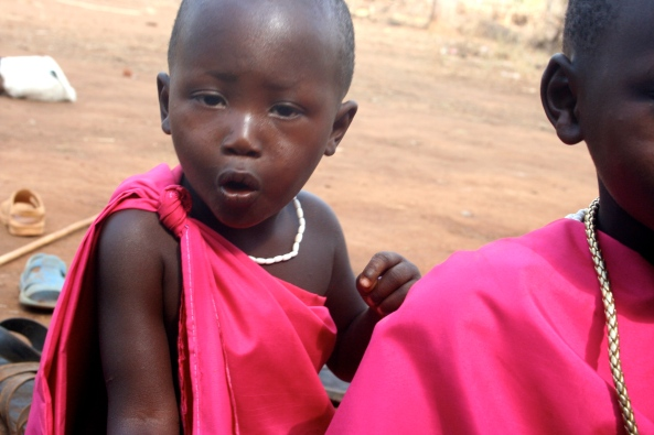 Emmanuel's mother snapped this shot.  The fierce little warrior  was shocked to see her with a camera.