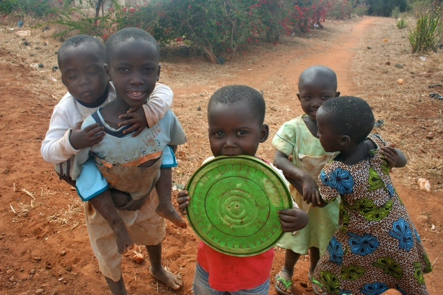 More village kids. Anything functions as a toy.