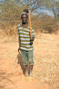 This is Nelson.  He carries a machete and a hoe in hopes of being hired to clear brush.