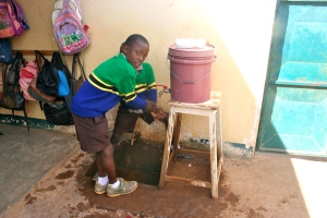 One of the 2 school sinks. The small bottle on top is filled with soapy water so the kids can wash.