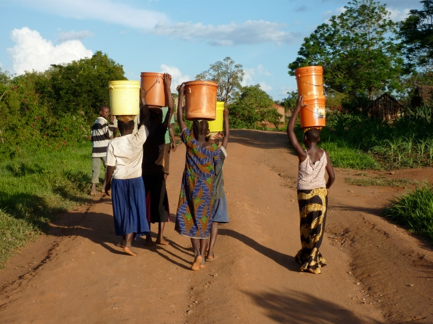 Women and girls carrying heavy buckets on their heads is a common, daily sight.